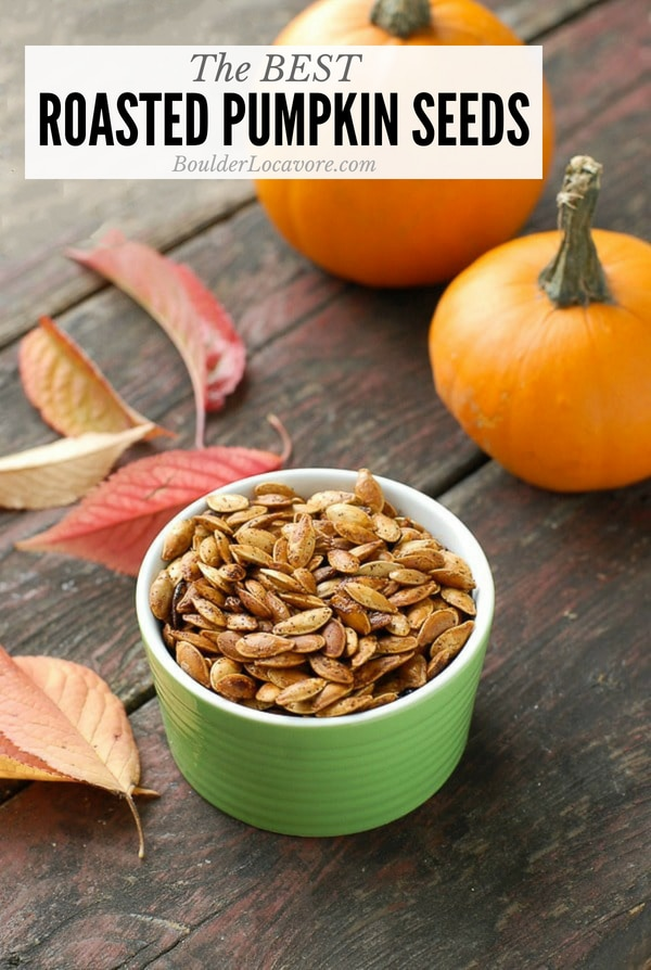 Roasted Pumpkin Seeds with powdered chipotle and small pumpkins in background
