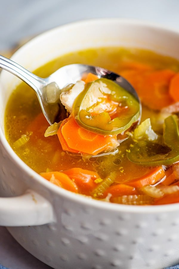 close up of homemade chicken and vegetable soup with jalapenos