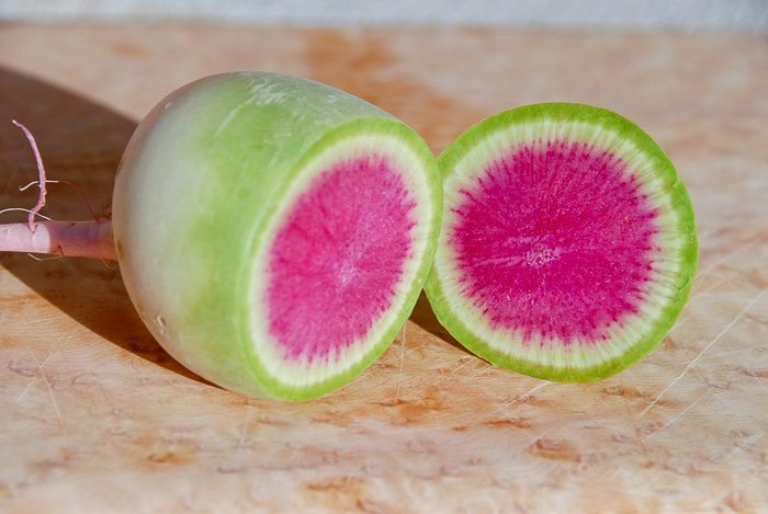 halved Watermelon Radish with green exterior, white ring and pink center