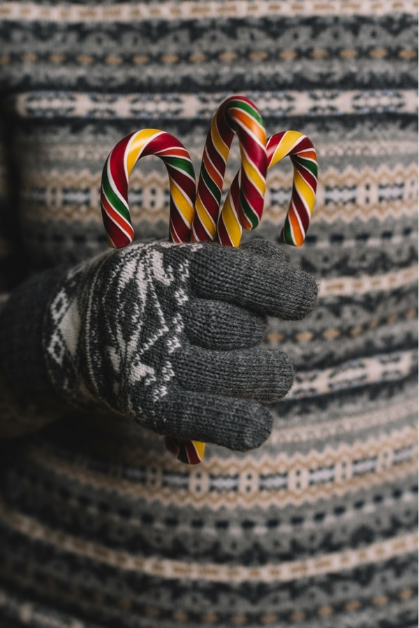 St. Nicholas Eve - handful of candy canes with gray wool gloves BoulderLocavore.com