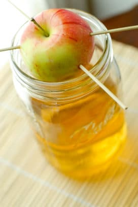 Homemade Apple-Infused Vodka in jar