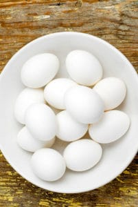 hard boiled eggs in a white bowl