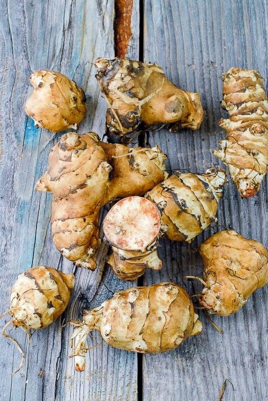 Raw Sunchokes or Jerusalem Artichokes on wood