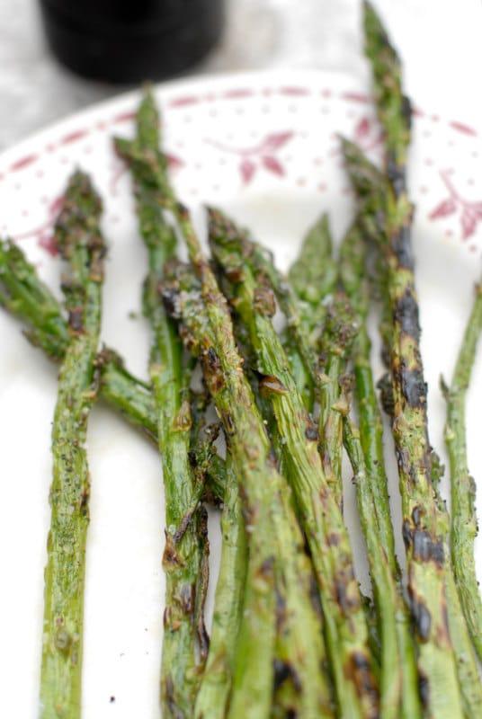 grilled asparagus on a floral platter
