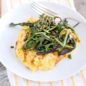polenta on plate with sautéed greens