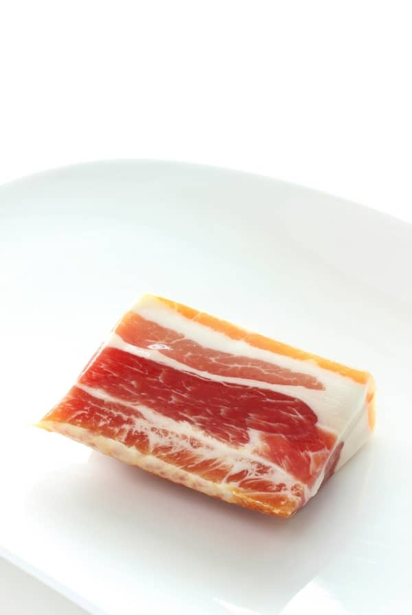 Pancetta on a white plate