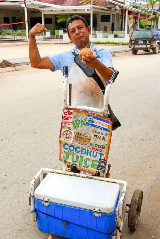 Fresh coconut milk street vendor with cooler in Costa Rica