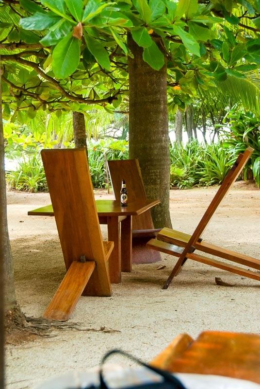 teak wood chair on the beach at Lola's playa avellana Costa Rica