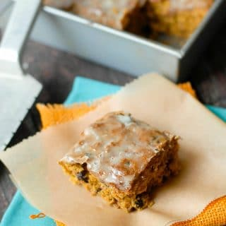 Perfect Pumpkin Bars. Pumpkin cake with nuts, raisins and a tasty orange glaze. Gluten-free and regular flour options. BoulderLocavore.com