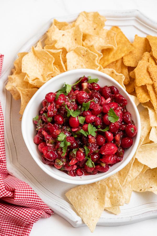 Cranberry Salsa with cilantro leaves and tortilla chips