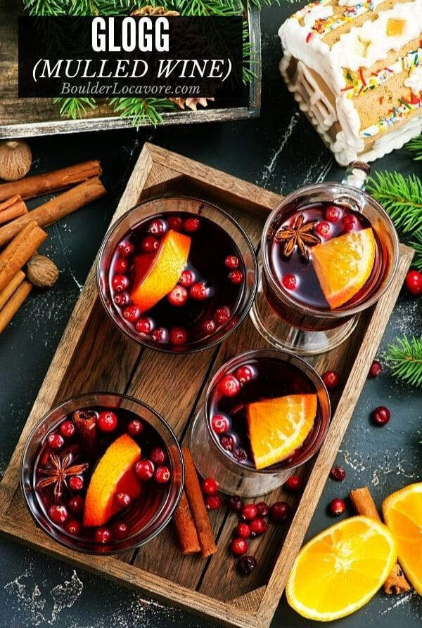 glass mugs of Glogg mulled wine on a wooden tray