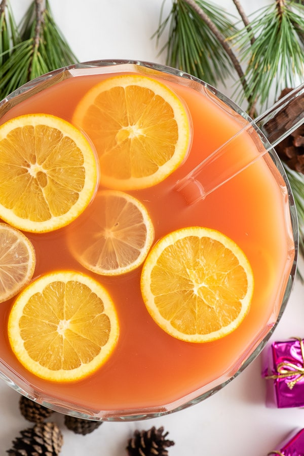 Wassail in punch bowl with citrus slices