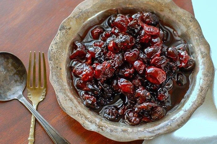 homemade brandied cranberries in a silver vintage bowl