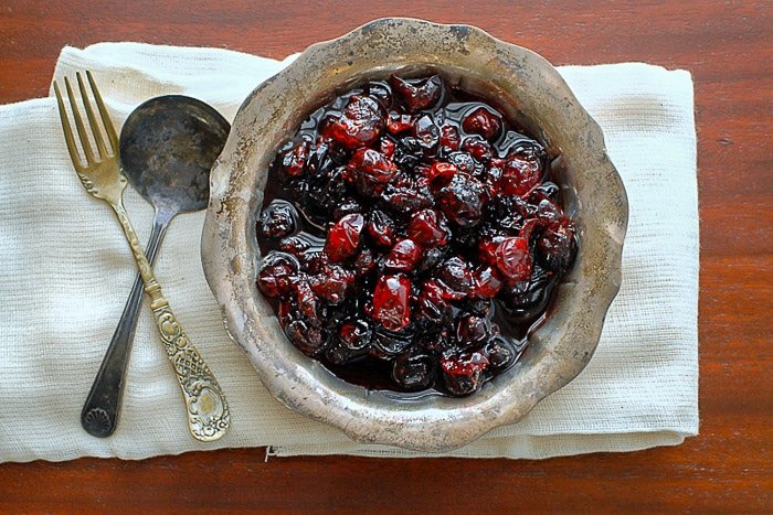 brandied cranberries in a vintage silver bowl with cutlery