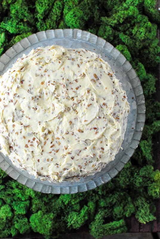The Best Hummingbird Cake combines banana bread and carrot cake flavors, on a galvanized metal pedestal cake plate. BoulderLocavore.com