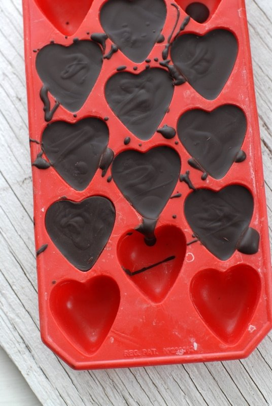 Dark chocolate hearts in mold
