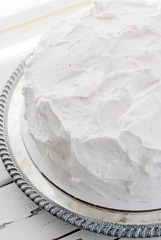 happy day cake frosted with strawberry whipped cream frosting
