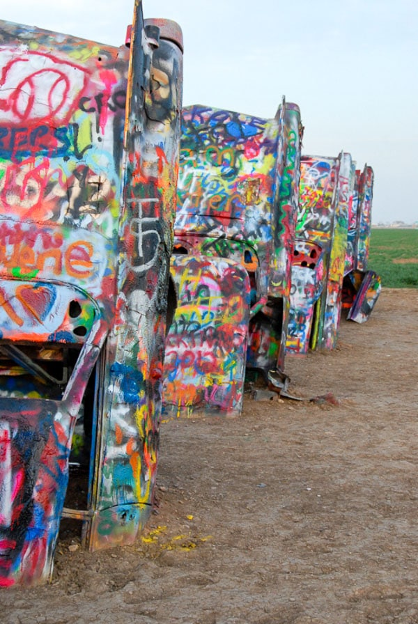 Close up of painted cars at Cadillac Ranch Amarillo Texas