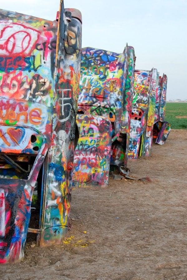 Close up of painted cars at Cadillac Ranch Amarillo Texas