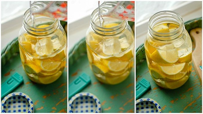 Lemons in jar with vodka infusing