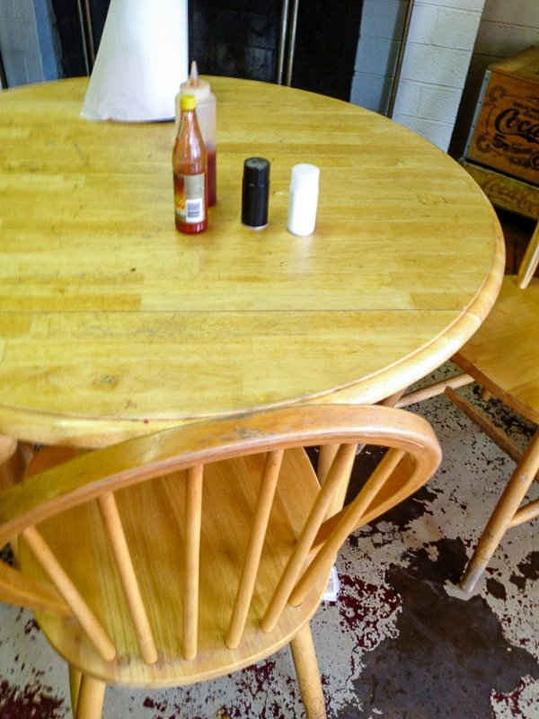Wood table and chairs on painted floor Robinson's BBQ Amarillo TX