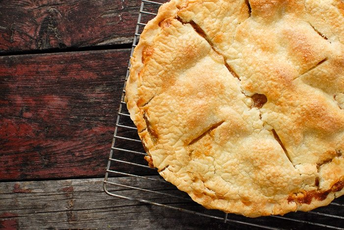 golden brown crust of pear pie on cooling rack