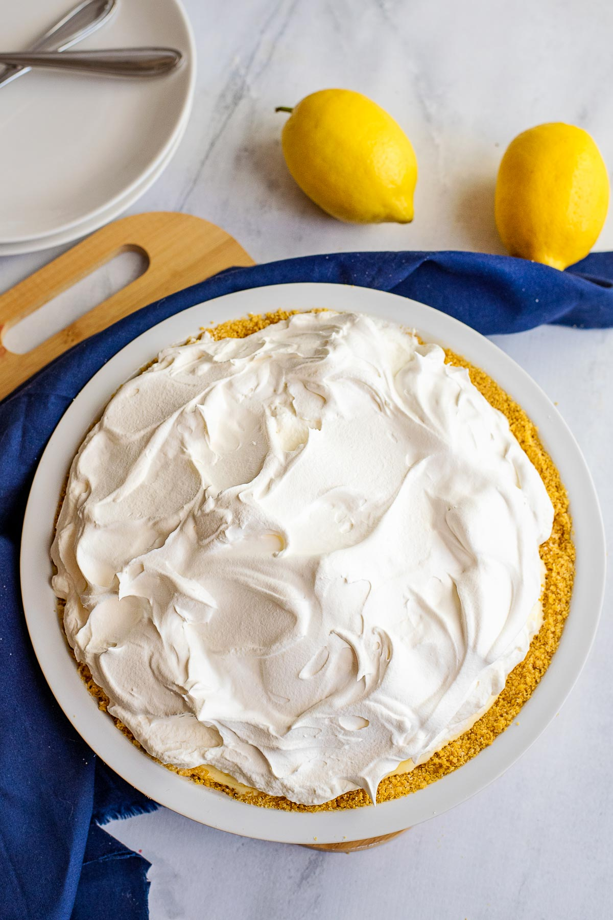 lemon chiffon pie topped with whipped cream