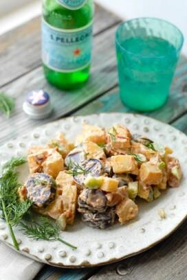 Tri Color Chipotle Bacon Potato Salad on a white ceramic plate