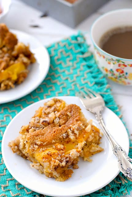 small white plate of Fresh Peach Sour Cream Coffee Cake