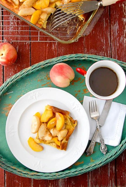 breakfast in bed tray holding a plate of Baked Pancakes with Sauteed Peaches