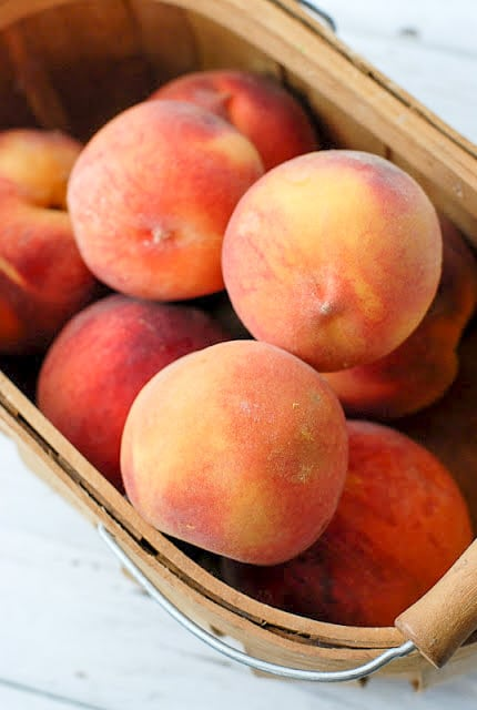 Fresh Summer Peaches in a wood basket - BoulderLocavore.com