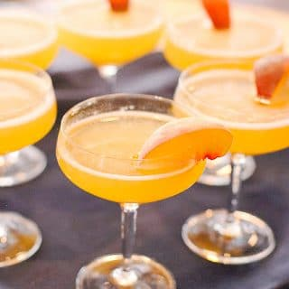 Peach Bellinis (cocktail recipe). A perfect summer cocktail with homemade peach nectar! Great for brunch or hot weather sipping. - BoulderLocavore.com
