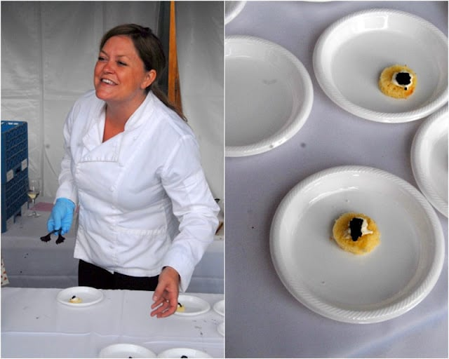 A person standing to plated appetizers