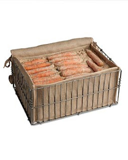 A close up of a box with carrots in root cellar