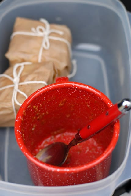 empty red enamel cup with spoon
