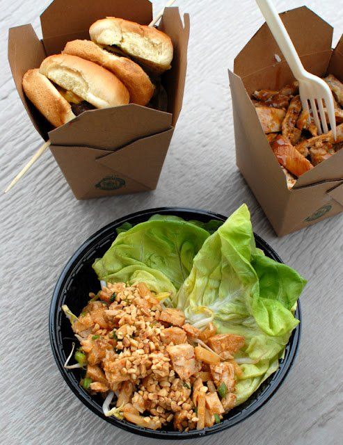 A box filled with different types of food on a table, with Asia