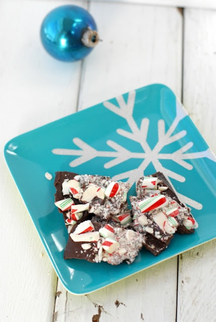 peppermint bark on a blue snowflake plate