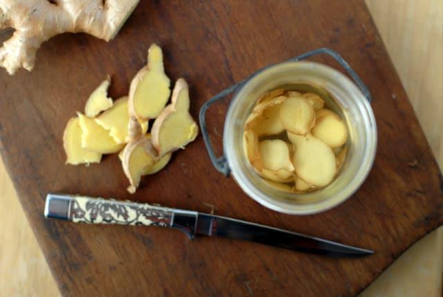sliced ginger in jar with vodka