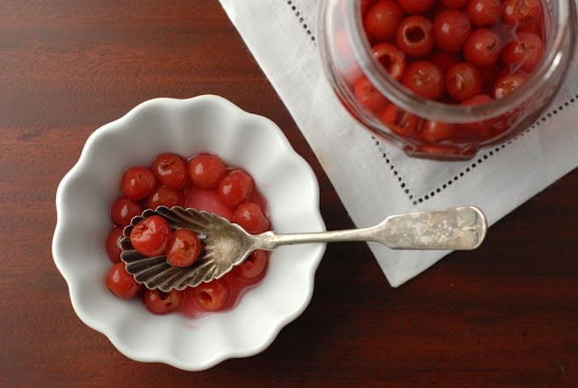 Homemade Maraschino Cherries in white bowl with spoon