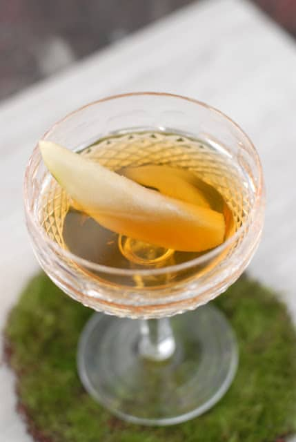 Pear infused Brandy in cocktail glass