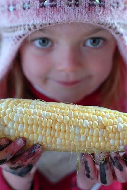 child and corn cob