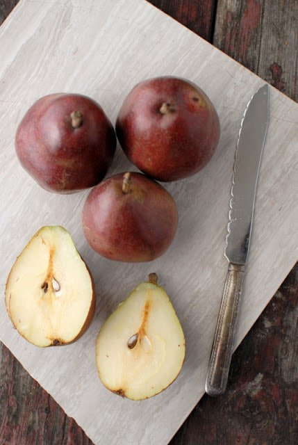red pears whole and sliced