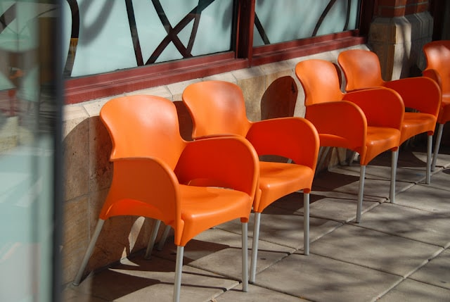 orange chairs outside Snooze Boulder