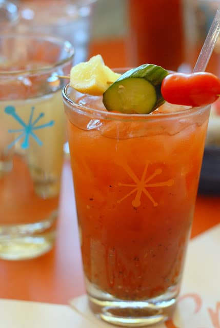 A glass of orange juice, with Bloody Mary