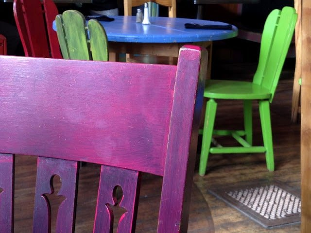 A chair sitting in front of a wooden table