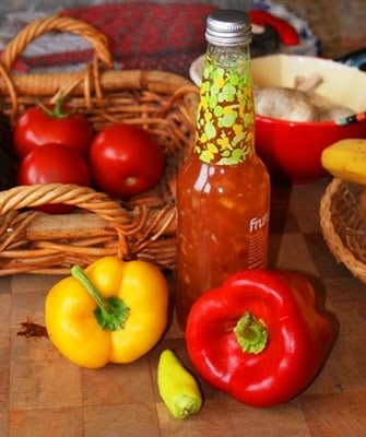 Food on a table, with Peppers and Sauce