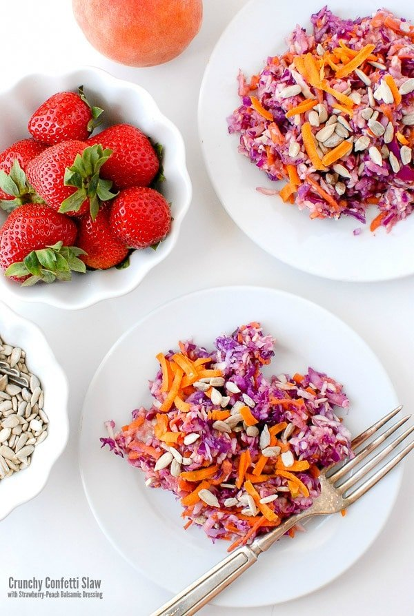 Crunchy Confetti Slaw with Strawberry-Peach Balsamic Dressing. This rainbow slaw is a showstopper. With a fruity balsamic dressing, it's quick to make, packed with nutrition and makes any meal happy! - BoulderLocavore.com