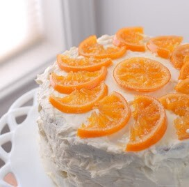 orange cardamom cake with candied oranges on top