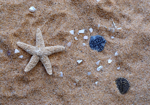 sand and pirate trinkets
