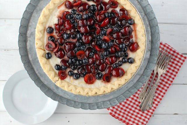 Cherry Blueberry Cloud Pie on a metal cake stand with checked napkin